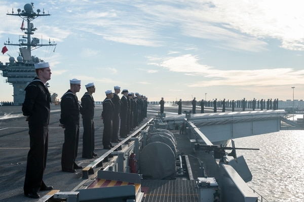 151116-N-DZ642-129 NORFOLK, Va. (Nov. 16, 2015) Sailors man the rails aboard aircraft carrier USS Harry S. Truman (CVN 75). TTruman Strike Group departs Naval Station Norfolk to deploy in support of maritime security operations and theater security cooperation efforts in the U.S. 5th and 6th Fleet areas of responsibility. With CVN 75 as the flagship, strike group assets include the embarked squadrons of Carrier Air Wing (CVW) 7, Destroyer Squadron (DESRON) 28 and ships USS Anzio (CG 68), USS Bulkeley (DDG 84), USS Gravely (DDG 107) and USS Gonzalez (DDG 66). (U.S. Navy photo by Mass Communication Specialist Seaman B. Siens/Released)