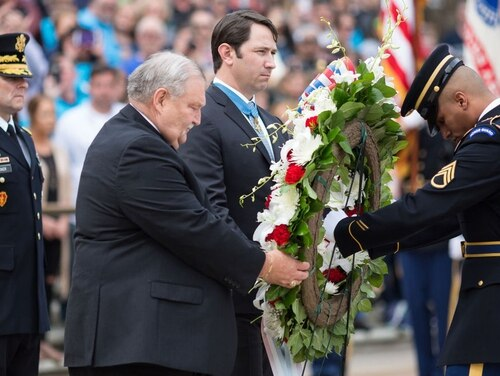 Medal of Honor recipients Mike Fitzmaurice and Will Swenson, center, participate in a wreath-laying ceremony commemorating valor and sacrifice on National Medal of Honor Day at the Tomb of the Unknown Soldier in Arlington National Cemetery on March 25. 2017. (Francis Chung/Defense Department)