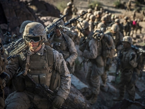 Marines with Kilo Company, Battalion Landing Team 3rd Battalion, 5th Marine Regiment, 11th Marine Expeditionary Unit, wait to begin a combined arms range during a predeployment training exercise at Marine Corps Air Ground Combat Center Twentynine Palms, California, Nov. 11. (Lance Cpl. Dalton S. Swanbeck/Marine Corps)