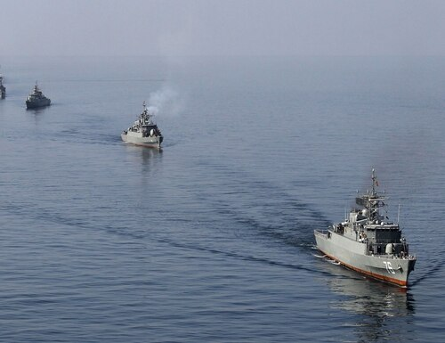 Iranian Navy ships take part in maneuvers during the