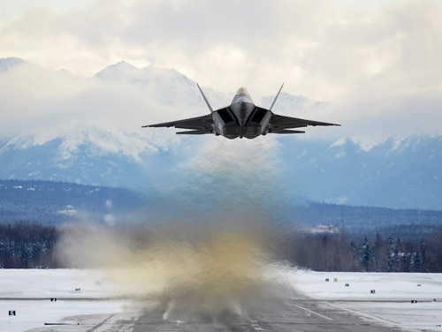 An Air Force F-22 Raptor assigned to the 3rd Wing flies over Joint Base Elmendorf-Richardson, Alaska, Feb. 27. The F-22 Raptor is the U.S. Air Force's premium fifth-generation fighter asset. ( Jamal Wilson/Air Force)