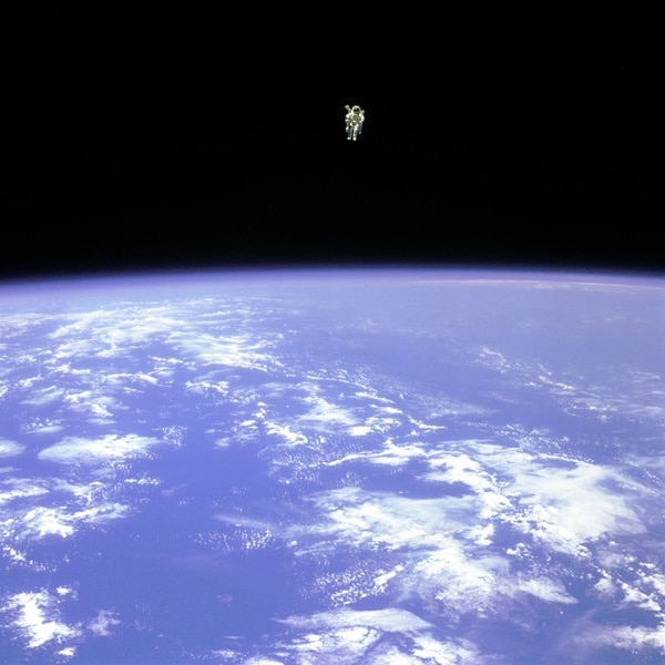 In this Feb. 12, 1984, photo made available by NASA, astronaut Bruce McCandless uses a nitrogen jet-propelled backpack, a Manned Manuevering Unit, outside the space shuttle Challenger. The Johnson Space Center says McCandless died Thursday, Dec. 21, 2017 in California. (NASA via AP)