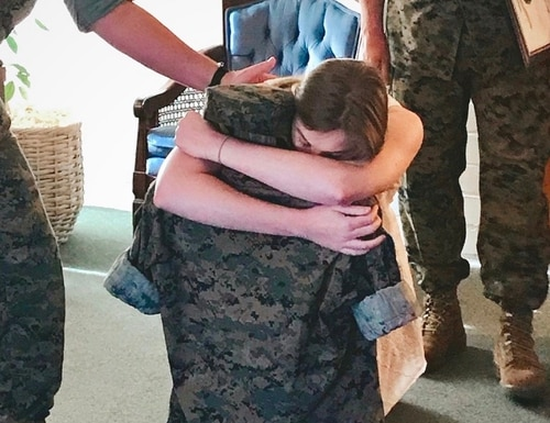Op-ed author Kathleen Bourque after she pinned Marine fiancé Conor McDowell's first lieutenant bars on his blouse at the funeral home near Camp Pendleton, California. (Photo courtesy of Kathleen Bourque)