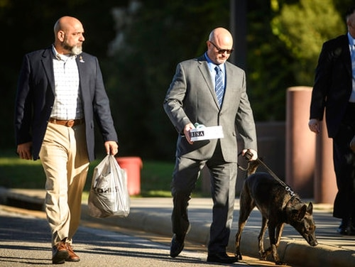 Retired Navy Seal James Hatch, center, arrives at the Fort Bragg courthouse to testify in the Army Sgt. Bowe Bergdahl's sentencing hearing on Wednesday, Oct. 25, 2017, on Fort Bragg, N.C. (Andrew Craft /The Fayetteville Observer via AP)