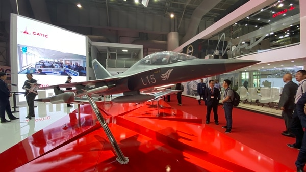 The Chinese defense industry showcases a model of its L-15 trainer at the Dubai Airshow on Nov. 19, 2019. (Jeff Martin/Staff)