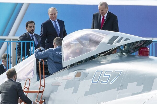Russian President Vladimir Putin, center, and Turkish President Recep Tayyip Erdogan, right, inspect a Sukhoi Su-57 fifth-generation fighter during the MAKS-2019 show in Zhukovsky, outside Moscow, Russia, on Aug. 27, 2019. (Pavel Golovkin/AP)