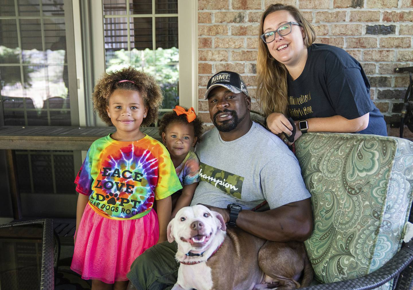 From left, Zaida Brooks, 5, Waverly Brooks, 2, their father, Omar Brooks, and mother, Nicole Malesic, pose for a photo with Maisie Mae, a foster dog at Bridge To Home Animal Rescue on Monday, July 6, 2020, in Eighty Four, Pa.