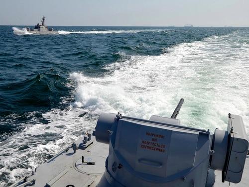 Two Ukrainian forces navy ships are seen near Crimea. The Ukrainian navy says a Russian coast guard vessel rammed a Ukrainian navy tugboat near Crimea, damaging the ship's engines and hull. (Ukrainian Navy Press Service via AP)