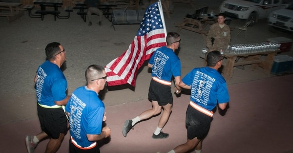 The pursuit of fitness is critical for troops who want to support their fellow service members, and for veterans who want to assist their families and communities, the author writes. Here, soldiers participate in a Run for the Fallen on Kandahar Airfield, Afghanistan, in 2014. (Spc. Ariel Solomon/Army)