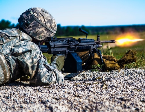 A Michigan National Guard Soldier with Headquarters and Headquarters Company fires the M249 Squad Automatic Weapon (SAW) during a live fire exercise. The Army is looking to revolutionize small arms by starting with a next generation weapon to replace the SAW. (Spc. Alan Prince/Michigan Army National Guard)