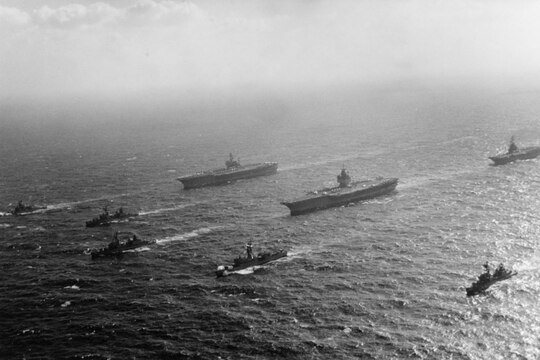 The aircraft carriers America, Enterprise and Oriskany cruise together in close formation in the South China Sea on Jan. 28, 1973 (Photo courtesy of the National Archives)