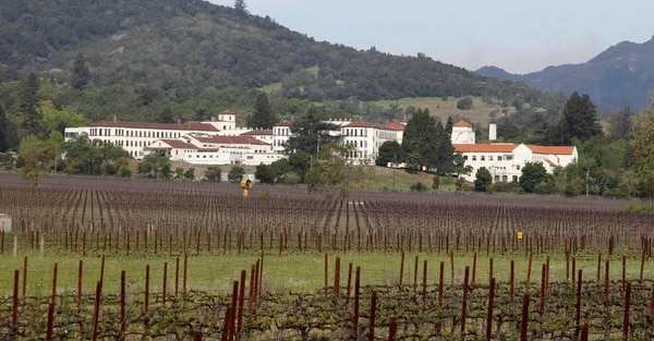 Reports say a gunman entered the Veterans Home of California in Yountville wearing body armor and has taken hostages. Here, the home is shown in 2011 behind a nearby vineyard. (Eric Risberg/AP)