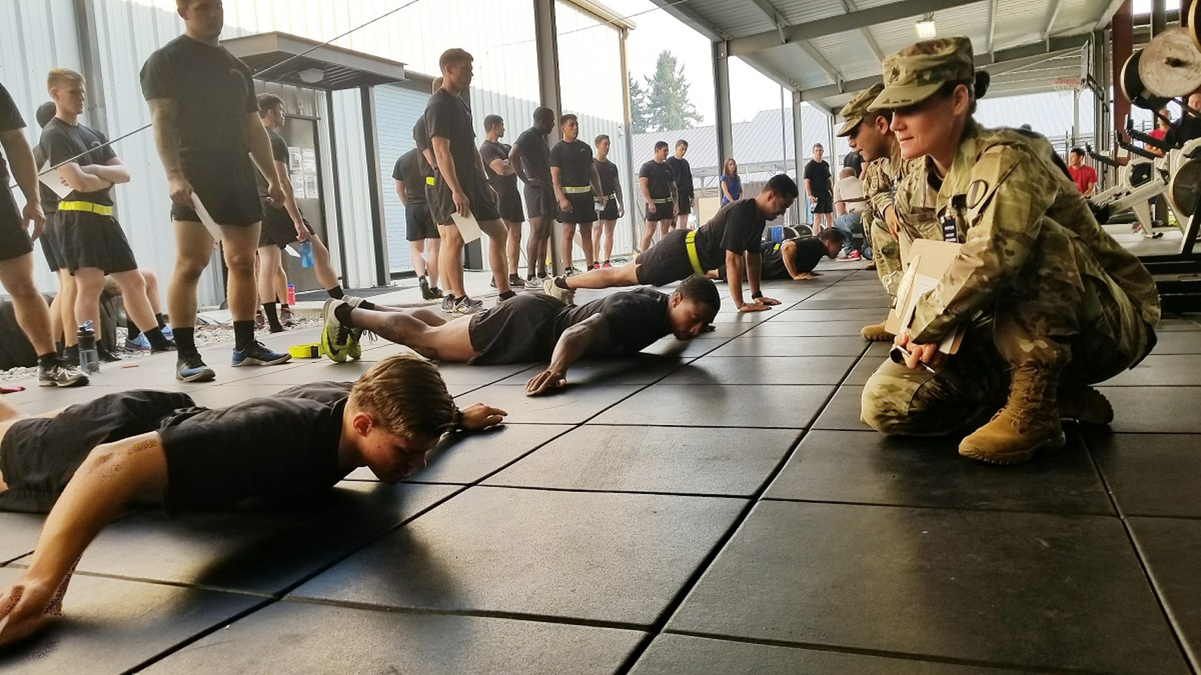 An Army Reserve soldier and master fitness trainer with the Army Physical Fitness School observes for proper form as soldiers assigned to 2nd Battalion, 75th Ranger Regiment at Joint Base Lewis-McChord, Washington, perform T pushups. (Stephanie Slater/Army)