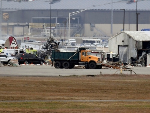 A fire-and-rescue operation is underway where World War II-era bomber plane crashed at Bradley International Airport in Windsor Locks, Conn., Wednesday, Oct. 2, 2019. (Jessica Hill/AP)