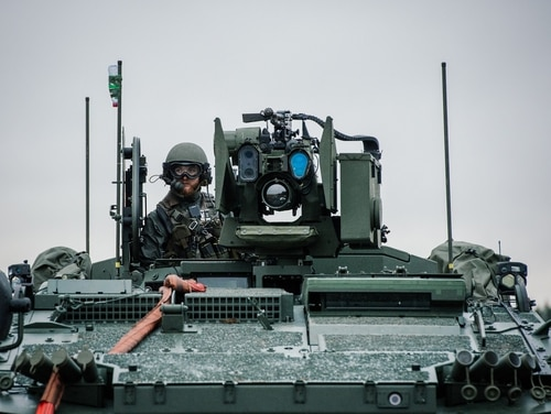 A soldier from the Swedish Armed Forces, looks on from top of the Patria XA-360 AMV (Armored Modular Vehicle) at Hagshult Airbase, part of the Forward Operation Base of the NBG about 240km North-East of Malmo, Sweden on November 6, 2014.The Nordic Battlegroup is one of European Union battlegroups. From 1 of January 2015 the NGB will be ready for a deployment on behalf of the EU. The Exercise joint action ends a year of preparation and training for the seven countries (Sweden, Finland, Norway, Ireland, Estonia, Latvia and Lithuania) and more than 2,400 members of the Nordic Battlegroup. AFP PHOTO / JONATHAN NACKSTRAND (Photo credit should read JONATHAN NACKSTRAND/AFP/Getty Images)