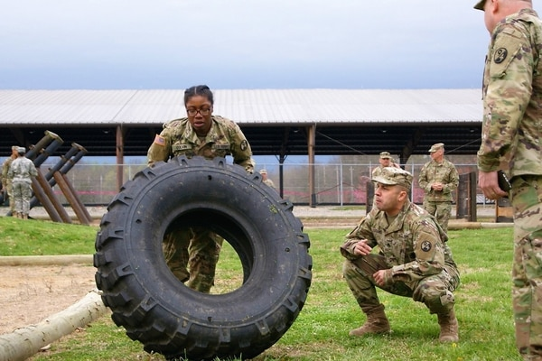 Spc. Alexis Colvin flips a 400-pound tire as part of the obstacle course in the 80th Training Command's Best Warrior Competition at Fort Knox, Ky., April 14. (Sgt. 1st Class Elizabeth Breckenkamp/Army)