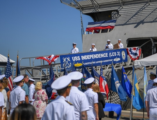 Ship's crew deliver the ensign and commissioning pennant during the decommissioning ceremony of littoral combat ship USS Independence (LCS 2). (MC1 Jason Abrams/U.S. Navy)
