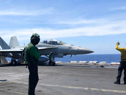 Crewmen of the U.S. aircraft carrier Theodore Roosevelt prepare their aircraft Tuesday, April 10,2018, in international waters off South China Sea. The aircraft carrier Theodore Roosevelt (CVN-71) is sailing through the disputed South China Sea in the latest display of America's military might after China built a string of islands with military facilities in the strategic sea it claims almost in its entirety. (Jim Gomez/AP)