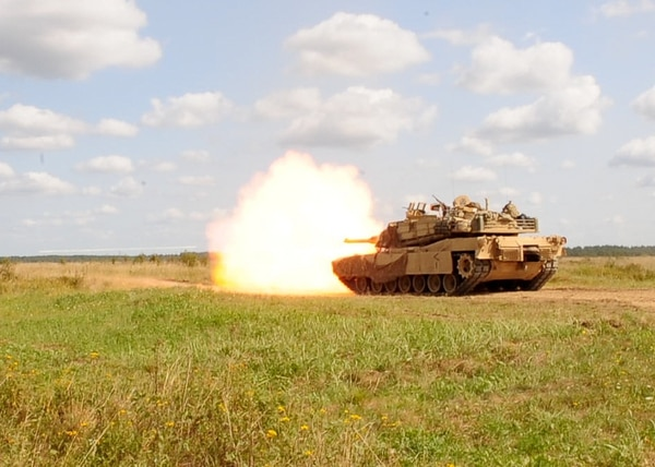 A M1A2 Abrams tank assigned to Alpha Company, 2nd Battalion, 8th Cavalry Regiment, 1st Armored Brigade Combat Team, 1st Cavalry Division, fires during a tank crew qualification gunnery at Drawsko Pomorskie Training Area, Poland. (Sgt. Lisa Vines/Army National Guard)