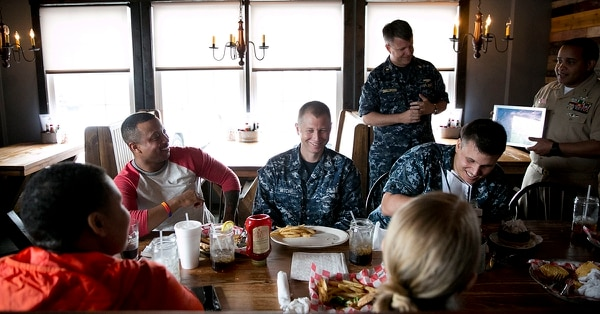 In this April 28, 2017, photo, Petty Officer 2nd Class Taryn McLean's co-workers host his