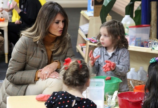 First lady Melania Trump watches as children form objects from Play-Doh at Joint Base Elmendorf-Richardson, Alaska, on Friday, Nov. 10, 2017. (Mark Thiessen/AP)