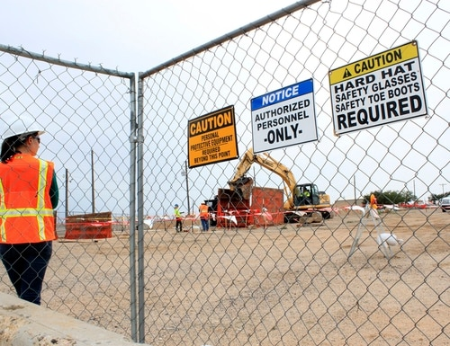 This Aug. 7, 2014, image shows a contract employee watching a crews excavate contaminated soil at a site where millions of gallons of jet fuel leaked underground over decades at Kirtland Air Force Base in Albuquerque, N.M. (Susan Montoya Bryan/AP)