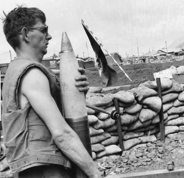A Marine bunker carries a 155mm shell to gun during an artillery duel with North Vietnamese troops at Khe Sanh, about 16 miles south of the demilitarized in South Vietnam, Jan. 29, 1968. (Rick Merron/AP)