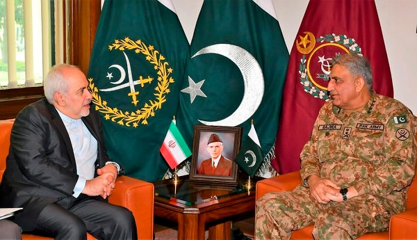 Iranian Foreign Minister Mohammad Javad Zarif, left, meets Pakistani Army Chief Gen. Qamar Javed Bajwa in Rawalpindi, Pakistan, on May 24, 2019. (Inter Services Public Relations via AP)