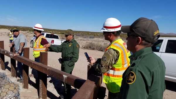 USACE engineers and Border Patrol agents discuss replacement of existing vehicle barriers with pedestrian border wall fencing near Columbus, N.M., on March 29, 2019. (Dave Palmer/Army Corps of Engineers)