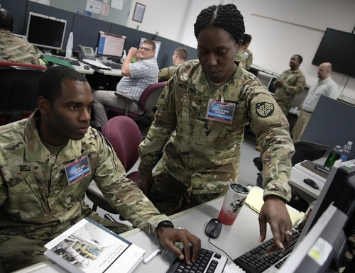 U.S. service members and civilians, along with partner nation service members, work to improve tactical-level cyber operations skills against a live opposing force at the Joint Training Facility in Suffolk, Va. (U.S. Cyber Command)