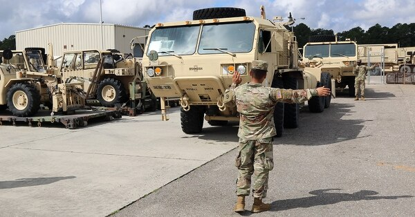 A 3rd Expeditionary Sustainment Command soldier lines up vehicle on Sept. 12, 2018, in preparation for Hurricane Florence at Fort Bragg, N.C.