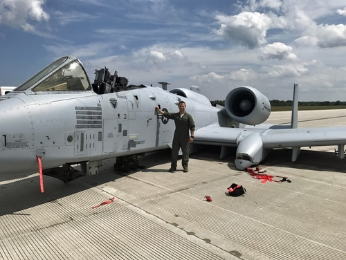 Capt. Brett DeVries, an A-10 Thunderbolt II pilot of the 107th Fighter Squadron from Selfridge Air National Guard Base in Michigan, poses next to the aircraft he safely landed after a malfunction forced him to make an emergency landing July 20, 2017, at the Alpena Combat Readiness Training Center. (Air National Guard)
