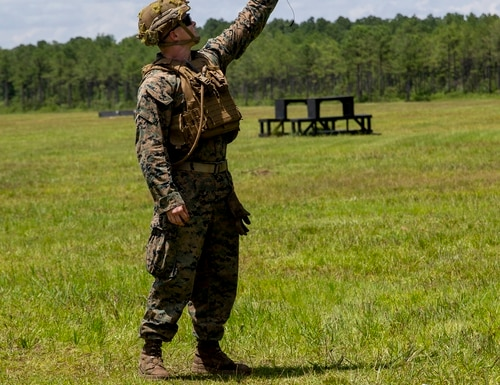 U.S. Marine Corps Pfc. Kyle Heutmaker, a rifleman with 1st Battalion, 2d Marine Regiment, 2d Marine Division, retrieves a Drone-40 during a training exercise at Camp Lejeune, N.C., July 7, 2021. (Pfc. Sarah Pysher/Marine Corps)