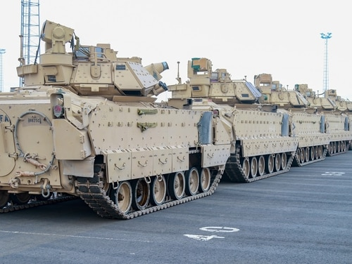 Combat vehicles of the 1st Armored Brigade Combat Team are unloaded at port ahead of training in support of Operation Atlantic Resolve, meant as a show of force near Russia's border with Europe. The Pentagon is increasingly focused on Russian deterrence in Europe, and additional U.S. troops may be in the mix. (Sgt. Christopher Case/Army)