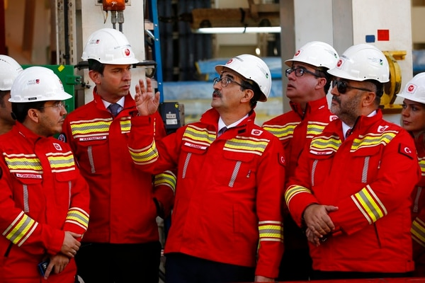 Fatih Donmez, center, Turkey's energy and natural resources minister, talks during a visit to Turkey's new drillship 'Conquerer' off the coast of Antalya, southern Turkey. (Lefteris Pitarakis/AP)