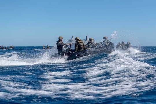 U.S. Marines with Battalion Landing Team 3/5, 31st Marine Expeditionary Unit, maneuver combat rubber raiding crafts after conducting call away drills in the Coral Sea July 19. The 31st MEU is operating aboard ships of the America Expeditionary Strike Group in U.S. 7th Fleet (Lance Cpl. Grace Gerlach/Marine Corps)