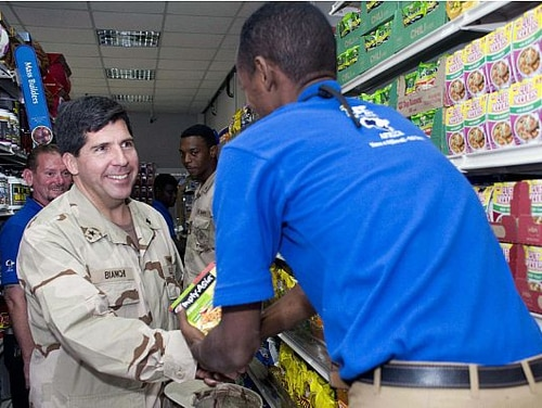 Rear Adm. Robert J. Bianchi, then-commander of Navy Exchange Service Command, visits the Navy Exchange at Camp Lemonier, Djibouti, in 2009. Bianchi took over as NEXCOM's chief executive in 2012 after his retirement from service, the first person to serve in the newly created civilian billet. (MC3 Jonathan P. Idle/Navy)