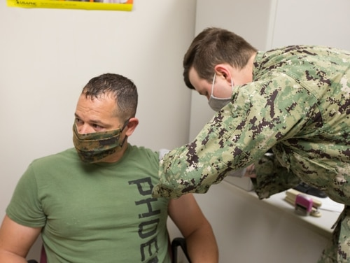 Marine Corps Sgt. Maj. James Robertson, the enlisted leader of Marine Corps Air Station Cherry Point, N.C., receives the Moderna COVID-19 vaccine on Dec. 23, 2020. (Marine Corps)