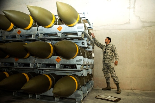 Staff Sgt. Jeric Hernandez, 86th Munitions Squadron quality assurance inspector, looks at a fresh shipment of large ordnance on Ramstein Air Base, Germany, Oct. 19. (Senior Airman Joshua Magbanua/Air Force)
