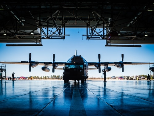U.S. Air Force crew chiefs with the 153rd Maintenance Group, Wyoming Air National Guard tow an aircraft inside a hangar to facilitate maintenance on April 21, 2016. (Master Sgt. Charles Delano/U.S. Air National Guard)