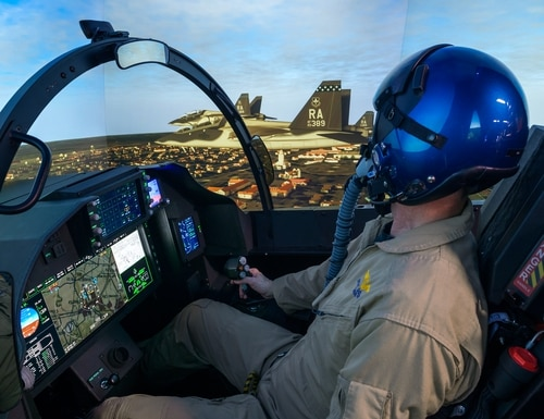 A Boeing test pilot flies the T-7A ground-based flight simulator. (Boeing)