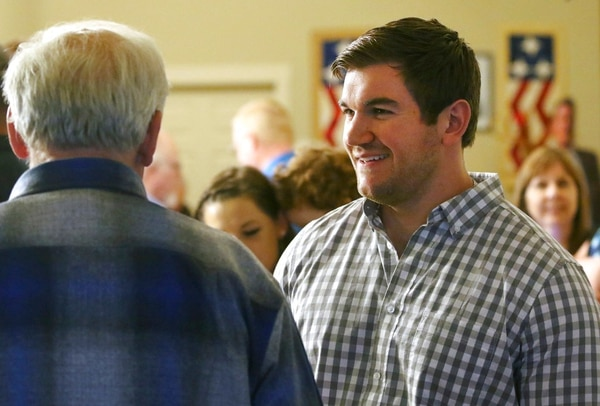Alek Skarlatos, right, speaks with former Douglas County Commissioner Mike Winters at the Douglas County Republican Party headquarters in Roseburg, Ore., Tuesday, May 15, 2018. (Michael Sullivan/The News-Review via AP)