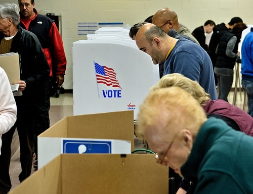 People wait in line to cast their ballots as others vote at the Potomac Community Recreation Center during early voting on Oct. 28, 2016, in Potomac, Maryland. (Brendan Smialowski/AFP/Getty Images)