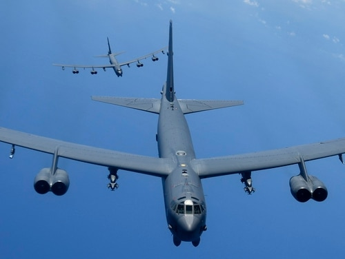 Two U.S. Air Force B-52H Stratofortress bombers fly over the Pacific Ocean during a routine training mission Aug. 2. (A1C Gerald R. Willis/ Air Force)