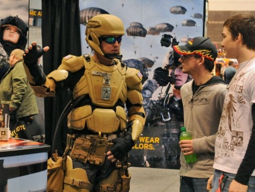 Sgt. 1st Class Matthew Oliver suits up in a futuristic combat uniform with a Tactical Assault Light Operator Suit-like look at the 2012 Chicago Auto Show. (Army)