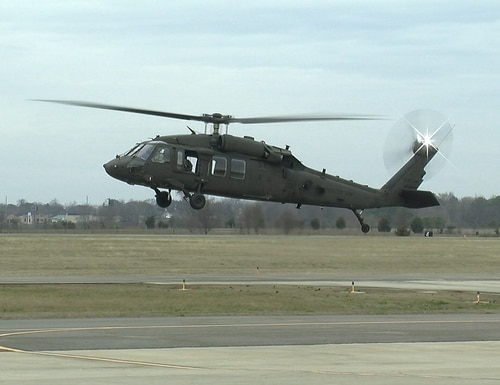 An engineering development model UH-60V Black Hawk hovers above the runway as part of its successful initial test flight Jan. 19, 2017 in Meridianville, Alabama. The UH-60V is being designed to update existing UH-60L analog architecture with a digital infrastructure to address evolving interoperability and survivability requirements. (Photo courtesy of U.S. Army)