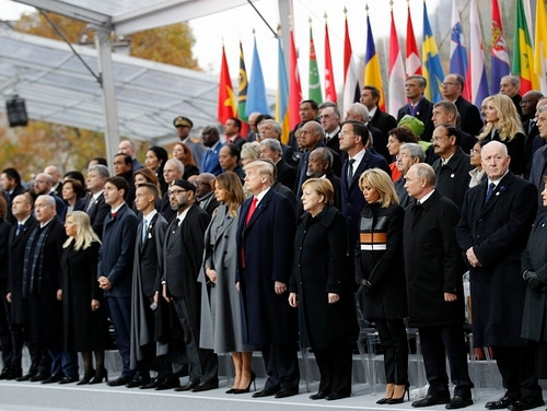 Heads of states and world leaders attend ceremonies at the Arc de Triomphe Sunday, Nov. 11, 2018 in Paris. Over 60 heads of state and government were taking part in a solemn ceremony at the Tomb of the Unknown Soldier, the mute and powerful symbol of sacrifice to the millions who died from 1914-18. (Francois Mori/Pool via AP)