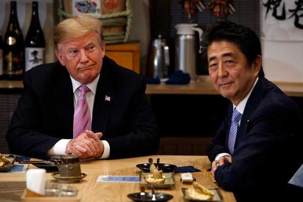 President Donald Trump sits at dinner with Japanese Prime Minister Shinzo Abe, Sunday, May 26, 2019, in Tokyo. (Evan Vucci/AP)