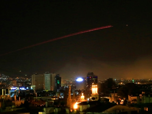 Damascus skies erupt with anti-aircraft fire as the U.S. launches an attack on Syria targeting different parts of the Syrian capital Damascus, Syria, early Saturday, April 14, 2018. (Hassan Ammar/AP)