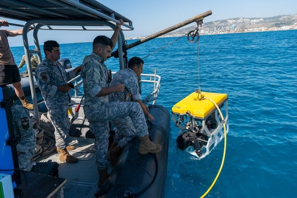 Members of the Lebanese Armed Forces deploy an underwater roving vehicle into the water during a mine-searching demonstration on May 24, 2021, as part of exercise Resolute Union in the Mediterranean Sea. (MC1 Daniel Hinton/U.S. Navy)